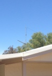 Dipole end tied off to a straining TV antenna pole